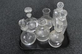 A tray of glass decanters,