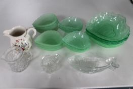 A tray of coloured green glass dishes etc