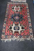 A Caucasian design rug,
