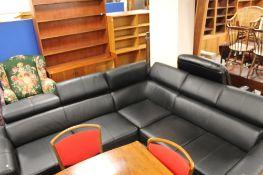 A black leather corner lounge suite