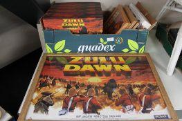 A box of five framed Zulu Dawn prints and six Zulu Dawn VHS box sets