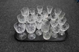 A tray of cut crystal glasses of various design