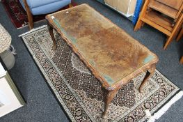 A walnut glass topped coffee table