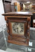 A continental oak cased bracket clock with silvered dial