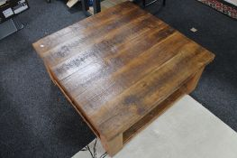 A heavy pine square coffee table