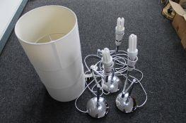 Three decorative adjustable chrome table lamps