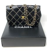 A lady's Chanel black stitched leather chain shoulder bag,