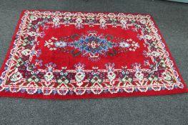 A woollen carpet of floral design,
