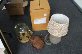 Three ornamental decorative table lamps together with a cow bell