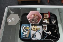 A tray of various silver and costume jewellery