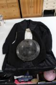 An early 20th century warden helmet together with a vintage waistcoat and tail coat