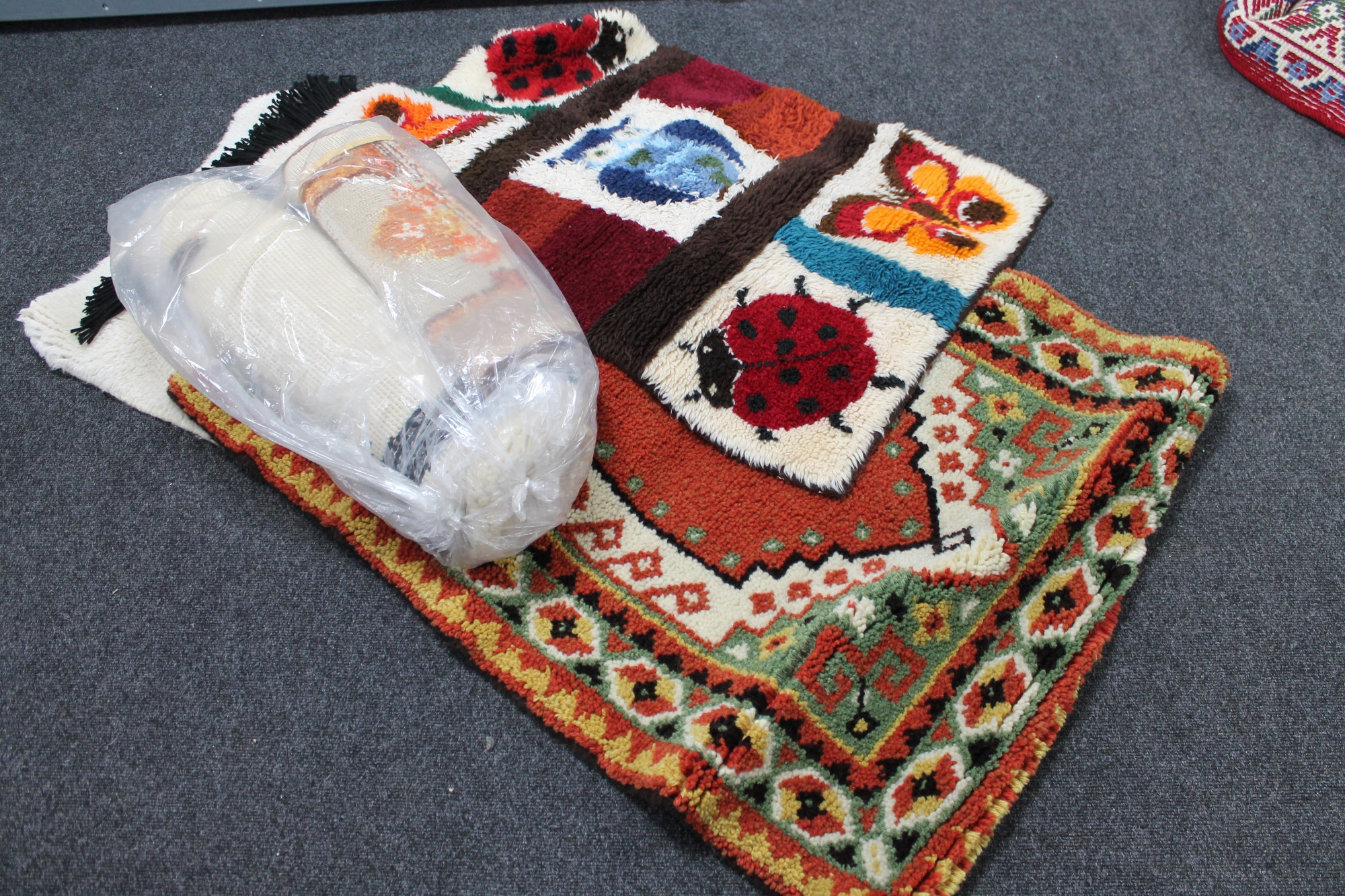 Lot 164 - A quantity of wool hangings and floor coverings