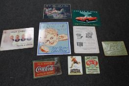A collection of reproduction metal advertising signs