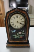A 19th century lacquered wooden mantel clock