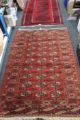 An Afghan Tekke rug, 121cm by 188cm (a/f) CONDITION REPORT: Torn in one area.