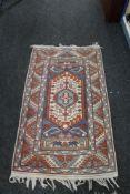A Persian rug of geometric design,