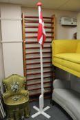 A flag on white pole