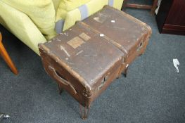 A vintage trunk on metal stand