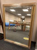 A golden framed mirror