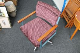 A mid 20th century metal framed swivel chair