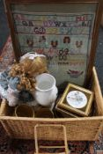 A wicker basket containing a tapestry sampler, Aynsley vase, ceramic plaques, doll,