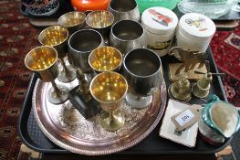 A collection of metal wares including a pair of brass elephant ornaments, two small brass bells,