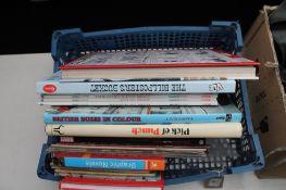 A basket of graphic novels, Viz annuals,