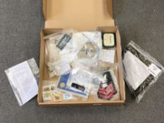 A box of a collection of military insignia, collector's cards,