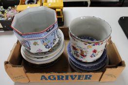 A box of decorative china plates,