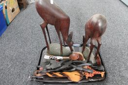 A tray of ornamental wooden eastern figures,