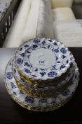 A quantity of Spode Blue Colonel blue and white gilded plates