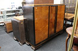 A two tone mid century double door side cabinet