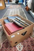 A box containing Cassell's Encyclopaedia,