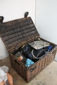 A wicker basket containing a collection of lady's handbags