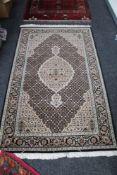 A Tabriz rug of millefiori design,