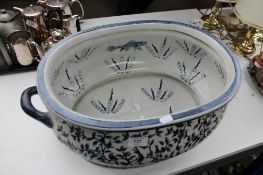 A reproduction blue and white Staffordshire style foot bath
