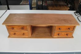 A four drawer wooden desk stand