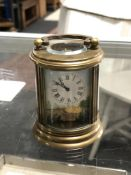 A brass enamelled French miniature carriage clock