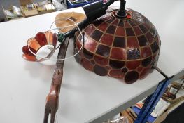 A vintage light fitting together with a mandolin