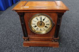 An Edwardian stained pine mantel clock