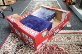 A box containing boxed set of goblets, dinner plates,