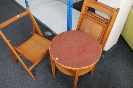 Four vintage folding chairs together with an occasional table