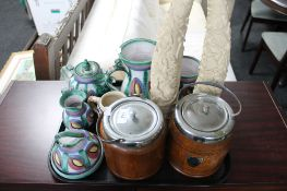A tray of earthenware china, two oak biscuit barrels,