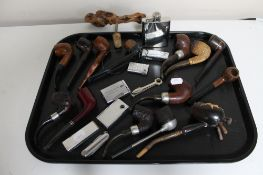 A large collection of pipes and lighters