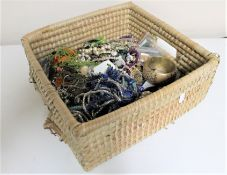 A wicker crate of costume jewellery