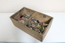 A wooden crate of costume jewellery, bangles,