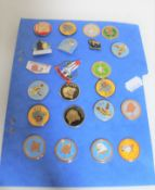 A collection of enamelled metal badges