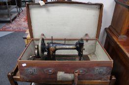 A Victorian Bradbury's sewing machine in vintage leather case