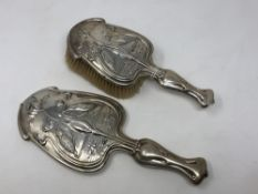A fine quality Art Nouveau brush and hand mirror depicting kingfishers