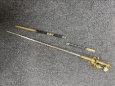 An antique court sword with etched blade,